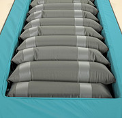 Long Bed Prints - Inflated Hospital Air Mattress Print by Mark Sykes