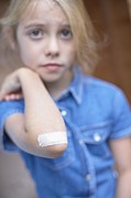 Plaster Photo Posters - Injured Girl Poster by Ian Boddy