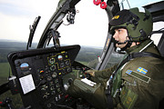 Helicopter Pilot Framed Prints - Inside The Mbb Bo 105 Helicopter Framed Print by Daniel Karlsson