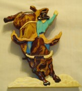 Rodeo Sculpture Framed Prints - Intarsia Bull-Rider Framed Print by Russell Ellingsworth