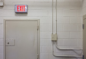 Exit Sign Prints - Interior Of A Prison Unit. Exit Sign Print by Roberto Westbrook