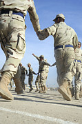 Bonding Art - Iraqi Air Force Recruits Celebrate by Stocktrek Images