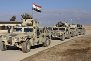 Baghdad Posters - Iraqi Army Soldiers Aboard M1114 Humvee Poster by Stocktrek Images