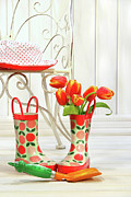 Gardening Tools Posters - Iron chair with little rain boots and tulips  Poster by Sandra Cunningham