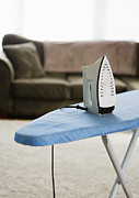 Appliance Posters - Iron on an Ironing Board Poster by Ben Sandall