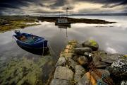 Calm Waters Prints - Islay, Scotland Two Boats Anchored By A Print by John Short