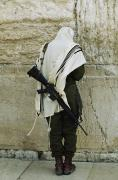 Armed Forces Framed Prints - Israeli Soldier With Rifle Praying Framed Print by Paul Chesley
