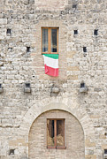 Hill Town Posters - Italian Flag Flying on a Medieval Building Poster by Rob Tilley