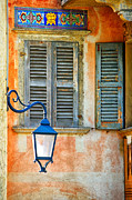 Weathered Shutters Framed Prints - Italian street lamp with window and decorated wall Framed Print by Silvia Ganora