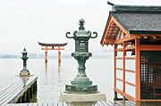 Torii Photos - Itsukushima Shrine by Rob Tilley