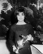 Lady Washington Framed Prints - Jacqueline Kennedy Holds A Silver Framed Print by Everett