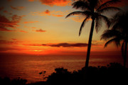Red Photographs Photo Prints - Jamaican Sunset Print by Kamil Swiatek