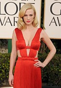 Beverly Hilton Hotel Framed Prints - January Jones Wearing A Versace Dress Framed Print by Everett