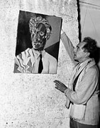 Self-portrait Photos - Jean Cocteau Adjusts His Self-portrait by Everett