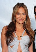 Gold Earrings Framed Prints - Jennifer Lopez Wearing An Emilio Pucci Framed Print by Everett