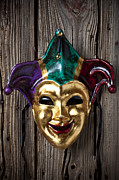 Masks Framed Prints - Jester mask hanging on wooden wall Framed Print by Garry Gay
