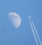 Moon Photography Posters - Jet Airplane With Smoke Trails Poster by Photo taken by Darren Olley