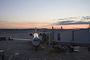 United Airlines Passenger Plane Photos - Jet bridge being attached to Canadair CRJ-200 by Purcell Pictures