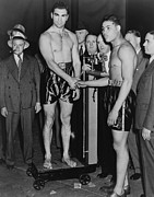 Boxer Photo Framed Prints - Joe Louis And Max Schmeling Weigh Framed Print by Everett