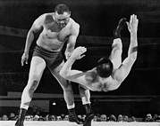 Heavyweights Prints - Joe Louis Throws Jim Bernard To The Mat Print by Everett