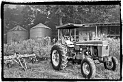 Old Photo Posters - John Deere in Black and White Poster by Debra and Dave Vanderlaan