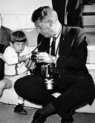 Candid Family Portraits Posters - John F. Kennedy Jr. Takes An Interest Poster by Everett