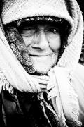 Poor People Photo Prints - Keeping warm Print by Gabriela Insuratelu