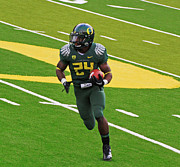 Oregon Ducks Prints - Kenjon Barner Oregon Ducks Print by Sam Amato