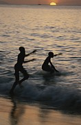 Silhouettes Metal Prints - Kids Race Into The Water For One Last Metal Print by Michael Melford