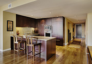 Hardwood Flooring Posters - Kitchen in Luxury Condo Poster by Andersen Ross