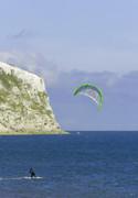 Kitesurfer At Yaverland Print by Rod Johnson