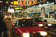 Buses Prints - Kowloon Street Scene At Night With Neon Print by Justin Guariglia