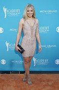 Peach Dress Framed Prints - Kristen Bell Wearing A Herve Leger Framed Print by Everett