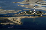Locations Metal Prints - La Gacholle Lighthouse surrounded with blue sea in Camargue Metal Print by Sami Sarkis