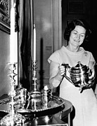 First Lady Photo Framed Prints - Lady Bird Johnson Holds A Silver Teapot Framed Print by Everett