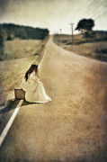 Rural Road Prints - Lady in Gown Sitting by Road on Suitcase Print by Jill Battaglia