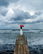 Turbulence Framed Prints - Lady on Dock in Storm Framed Print by Jill Battaglia