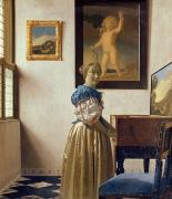 Satin Dress Painting Prints - Lady standing at the Virginal Print by Jan Vermeer