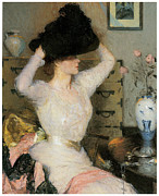 American Artist Paintings - Lady Trying on a Hat by Frank Weston Benson
