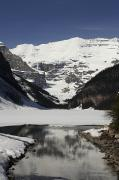 Rocky Mountains Prints - Lake Louise Is Just Beginning To Thaw Print by Stephen Alvarez