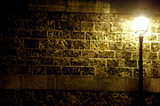 Night Lamp Prints - Lamp and a brick wall Print by Micah May