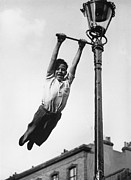 Child Swinging Art - Lamppost Tarzan by John Drysdale