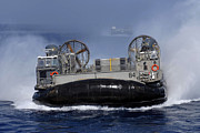 Boats On Water Photo Posters - Landing Craft Air Cushion 84 Conducts Poster by Stocktrek Images