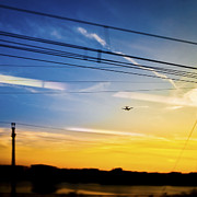 Beautiful Landing Prints - Landing Plane at Sunset Print by Eddy Joaquim