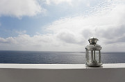 Ledge Prints - Lantern On Ledge Overlooking Sea, Ginostra, Stromboli Island, Aeolian Islands, Italy Print by Siephoto
