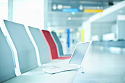 Life In Space Prints - Laptop On Chairs In Airport Waiting Area Print by Cultura/Luc Beziat