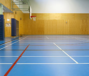 Basketball Sports Prints - Large Empty Gym With Basketball Court Print by Marlene Ford