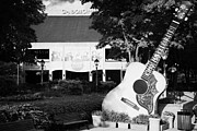 Grand Ole Opry Framed Prints - large guitar outside Grand Ole Opry House building Nashville Tennessee USA Framed Print by Joe Fox