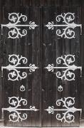 Wooden Building Posters - Large Metal Decorative Hinges On A Poster by Michael Interisano