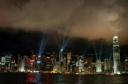 Sami Sarkis Prints - Laser show over city at night Print by Sami Sarkis